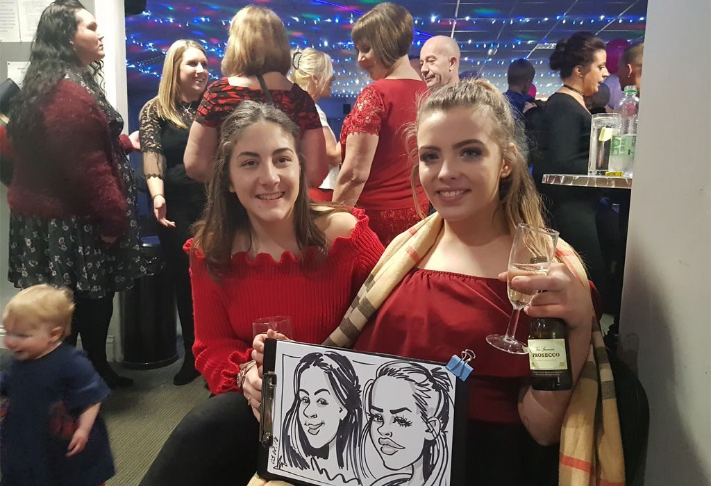 Live caricatures of 2 girls